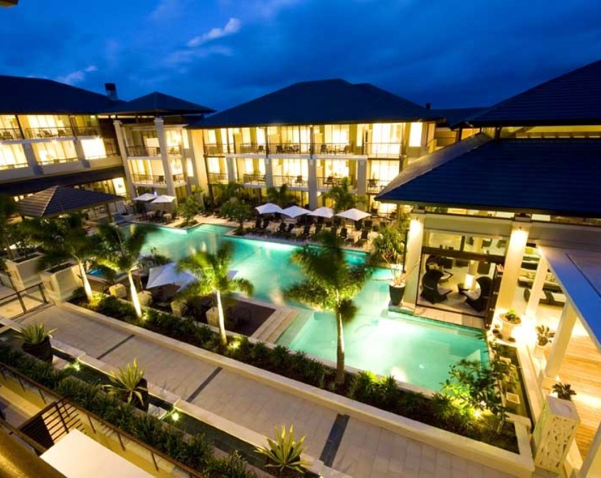 resort pool landscape palm trees